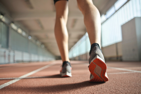 Image of runner on track. Honey provides a natural energy boost.