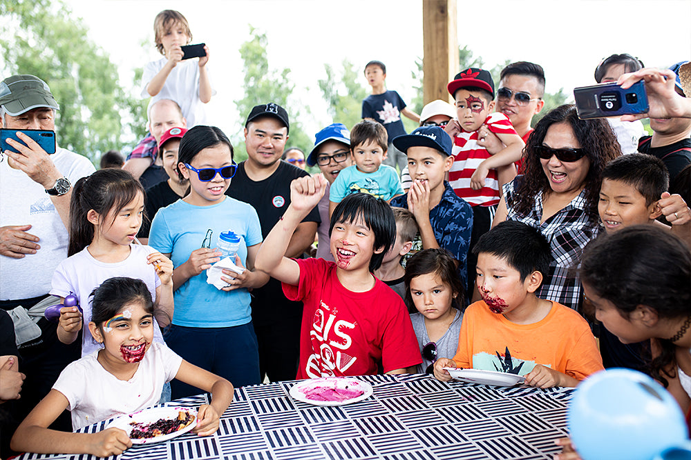 Children smiling after blueberry pie eating contest