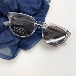 The Arrivals Zonne Clear Round Sunglasses Flat Lay