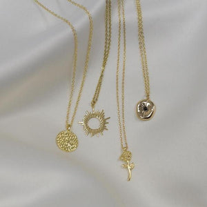 Hunter and Hare gold necklace collection