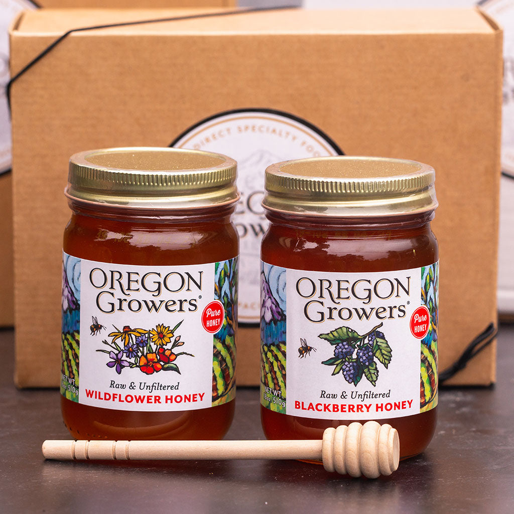 Jars of Blackberry and Wildflower Honey with wooden honey dipper in box
