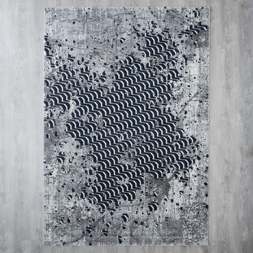 Distressed geo floor rug
