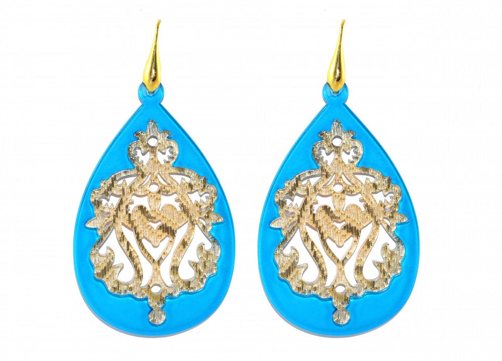 Blue resin drops with golden ornaments