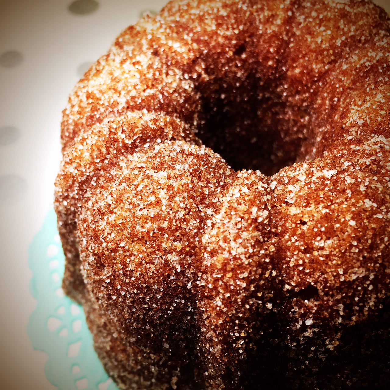all spice bundt cake with horchata glaze dusted in cinnamon sugar
