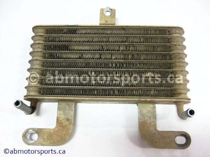 Used Arctic Cat ATV 700 H1 4x4 OEM part # 0413-211 oil cooler for sale
