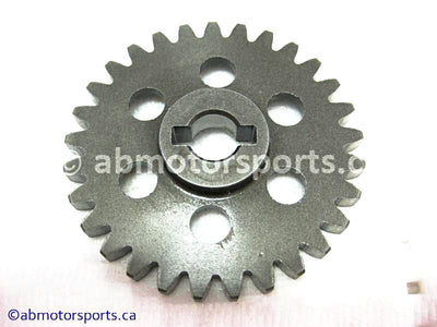 Used Arctic Cat ATV 500 AUTO FIS OEM part # 3402-026 water pump driven gear for sale