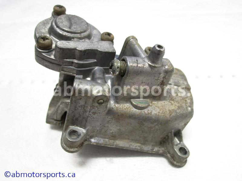 Used Arctic Cat ATV 500 AUTO FIS OEM part # 5507-065 carburetor bowl for sale