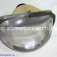 Used Arctic Cat Snow 580 EXT OEM part # 0609-172 head light for sale