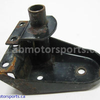 Used Arctic Cat Snow COUGAR 500 OEM part # 0704-006 right wheel mount bracket for sale