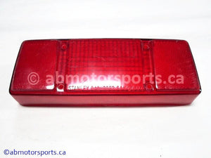 Used Arctic Cat Snow ZR 900 OEM part # 0609-090 tail light lens for sale