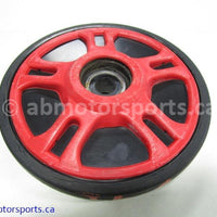 Used Arctic Cat Snow ZR 900 OEM part # 1604-767 idler wheel for sale