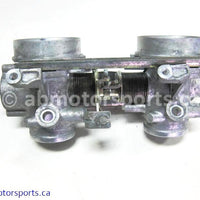 Used Arctic Cat Snow 580 EFI OEM part # 3005-050 or 3005-051 or 3005-052 throttle body for sale