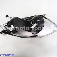 Used Arctic Cat Snow M8 Sno Pro OEM part # 0609-849 left headlight for sale