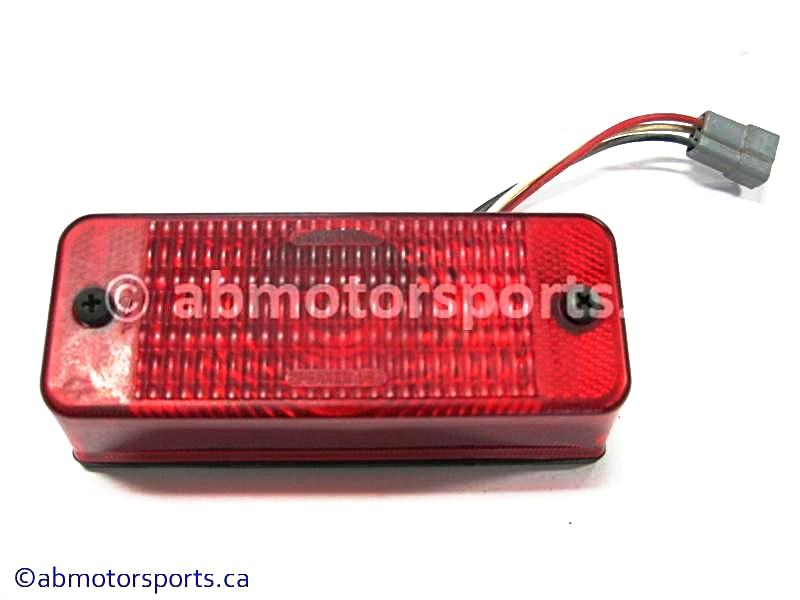 Used Can Am ATV TRAXTER MAX 500 XT OEM part # 710000102 tail light for sale
