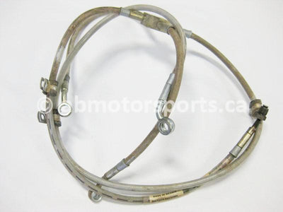 Used Can Am ATV OUTLANDER 800 OEM part # 705600579 front brake hose for sale