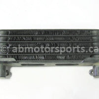 Used Honda ATV TRX 350 FM2 OEM part # 15600-HM7-610 oil cooler for sale