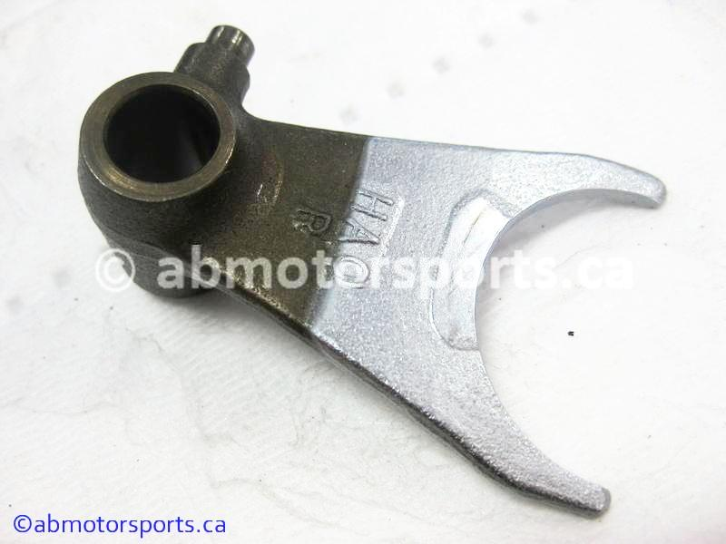 Used Honda ATV TRX 300 FW OEM part # 24211-HA0-010 right shift fork for sale