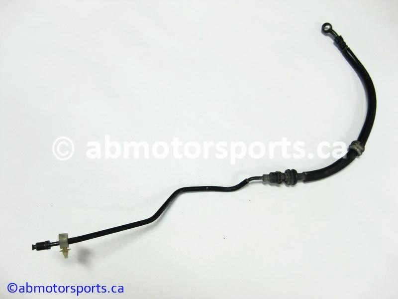 Used Honda ATV TRX 350 FM OEM part # 45128-HN5-670 front brake line for sale
