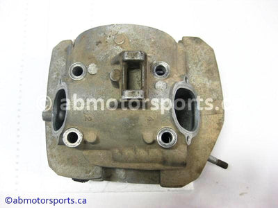 Used Kawasaki ATV KLF 300A OEM part # 11002-5042 cylinder head for sale