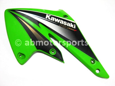 Used Kawasaki Dirt Bike KX 250 F OEM part # 49089-0020-290 left engine panel for sale