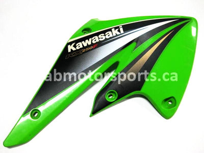 Used Kawasaki Dirt Bike KX 250 F OEM part # 49089-0021-290 right engine panel for sale
