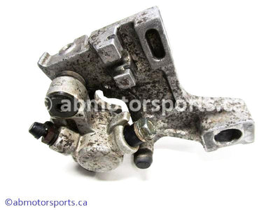 Used Kawasaki Dirt Bike KX 125 OEM part # 43041-1687 rear brake caliper for sale
