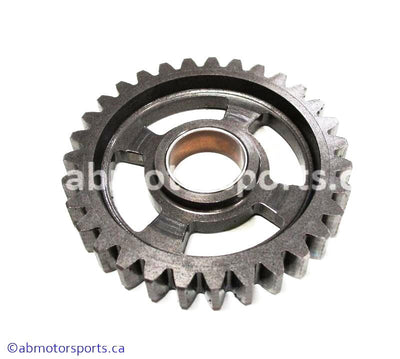 Used Kawasaki Dirt Bike KX 125 OEM part # 13260-1752 low output transmission gear for sale