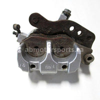 Used 2009 Kawasaki Teryx 750 LE OEM part # 43080-0079 front left brake caliper for sale