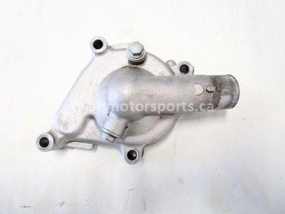 Used 2009 Kawasaki Teryx 750 LE OEM part # 16142-0002 water pump cover for sale