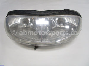 Used Polaris Snowmobile TRAIL RMK OEM part # 2410132 head light for sale