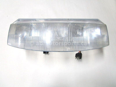 A used Headlight from a 1997 RMK 500 Polaris OEM Part # 2431008 for sale. Check out our online catalog for more parts that will fit your unit!