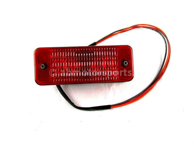 A used Tail Light from a 2000 RMK 600 Polaris OEM Part # 4032087 for sale. Check out our online catalog for more parts that will fit your unit!