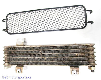 Used Suzuki ATV EIGER 400 OEM part # 16600-38F20 oil cooler assembly for sale