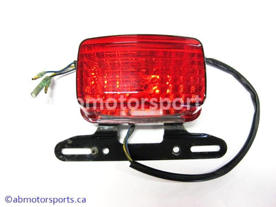 Used Yamaha ATV GRIZZLY 660 OEM part # 5KM-84710-00-00 tail light for sale