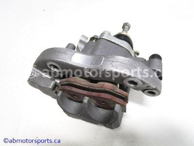 Used Yamaha ATV YFZ450 OEM part # 5TG-2580W-20-00 rear brake caliper for sale