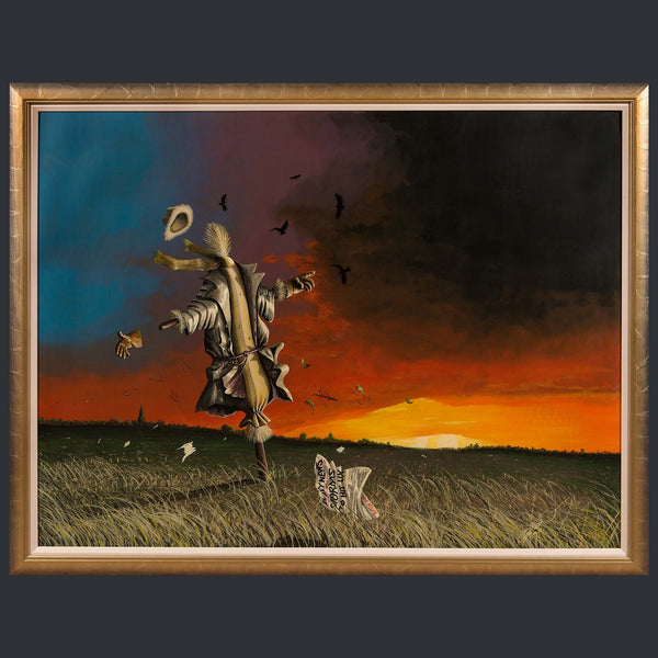 A scarecrow standing in a field, being blown in the wind with a sunset in the background.