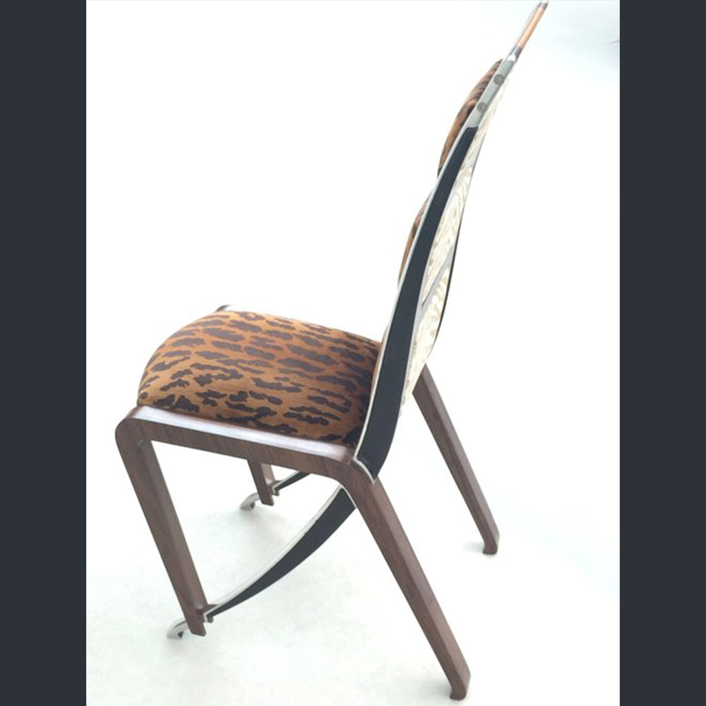 A chair with faux leopard print upholstery, wooden and powder coated cast aluminium legs by British designer Sebastian Blakeley