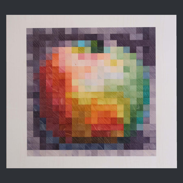 A pixelated red and green apple made of wood veneer pieces by Kevin Stamper