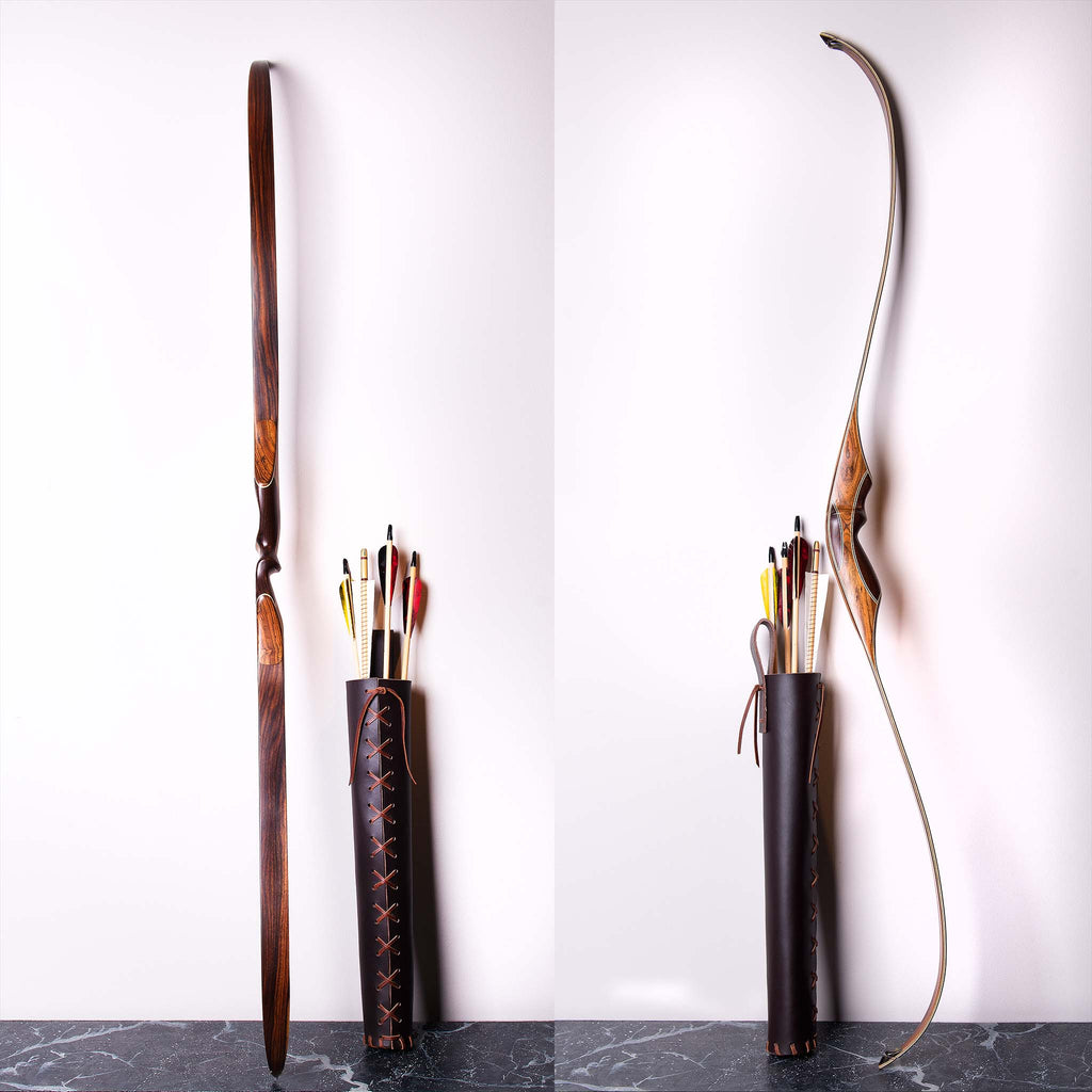 Bow and arrow leaning against a wall. The arrows are held in a leather tube and the bow has no string.