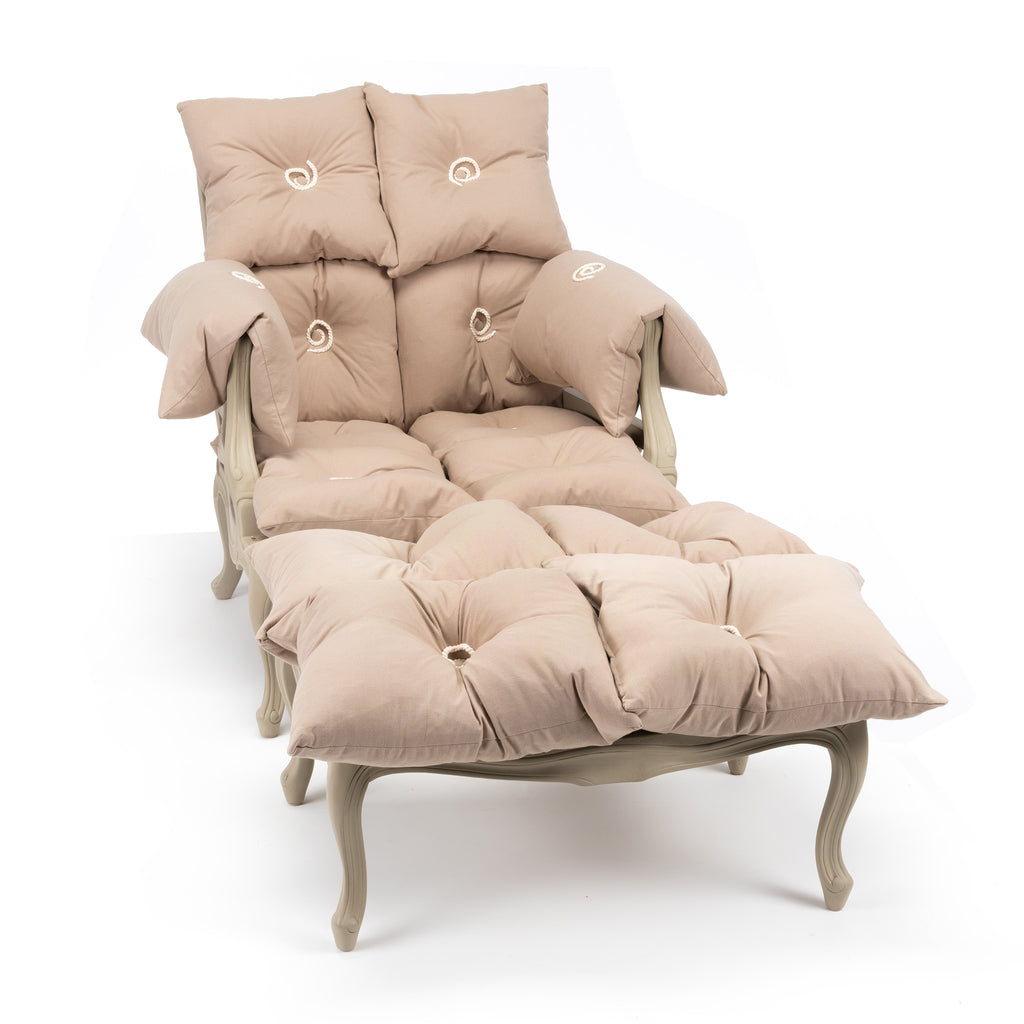 An armchair and foot stool made of individual cushions