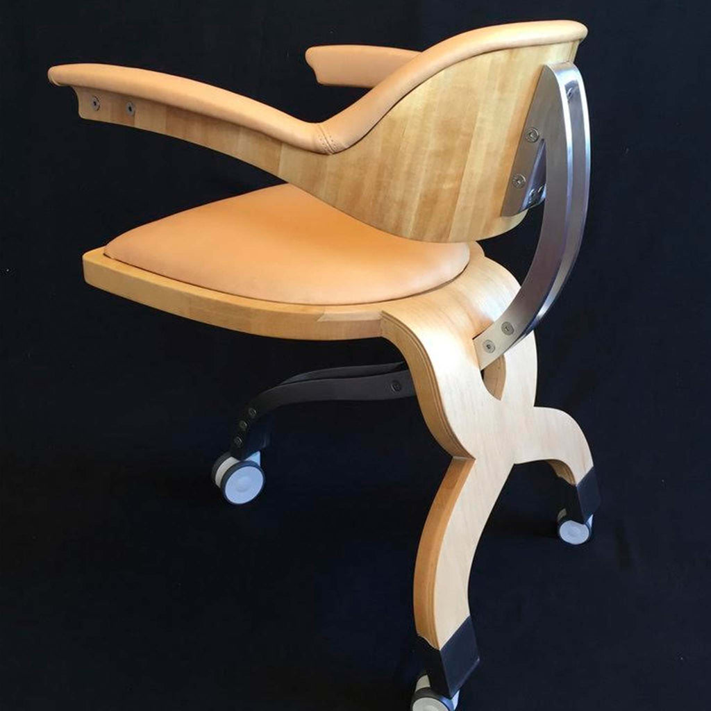 Hand crafted desk chair made with natural tan leather. A curved seat and backrest with arms