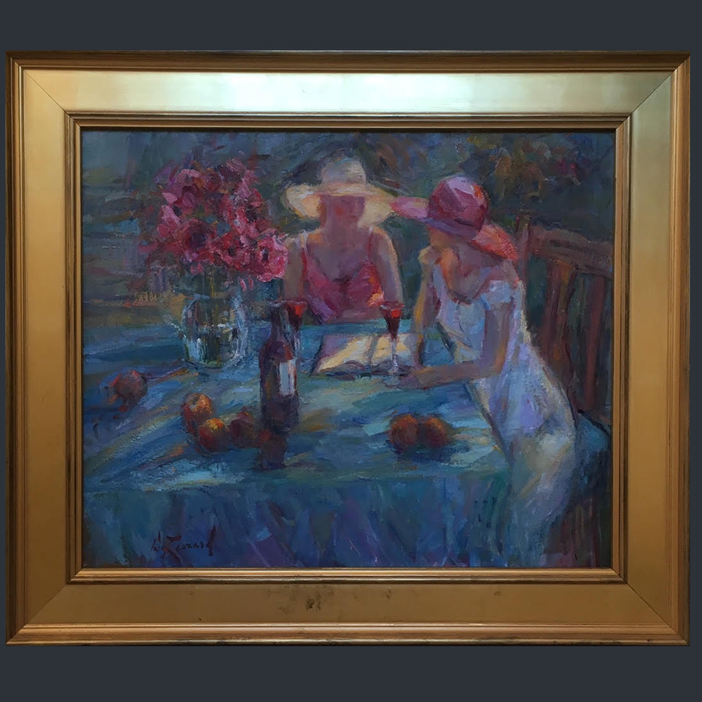Two women sitting at a table in the garden in summer having a glass of wine by Diane Leonard