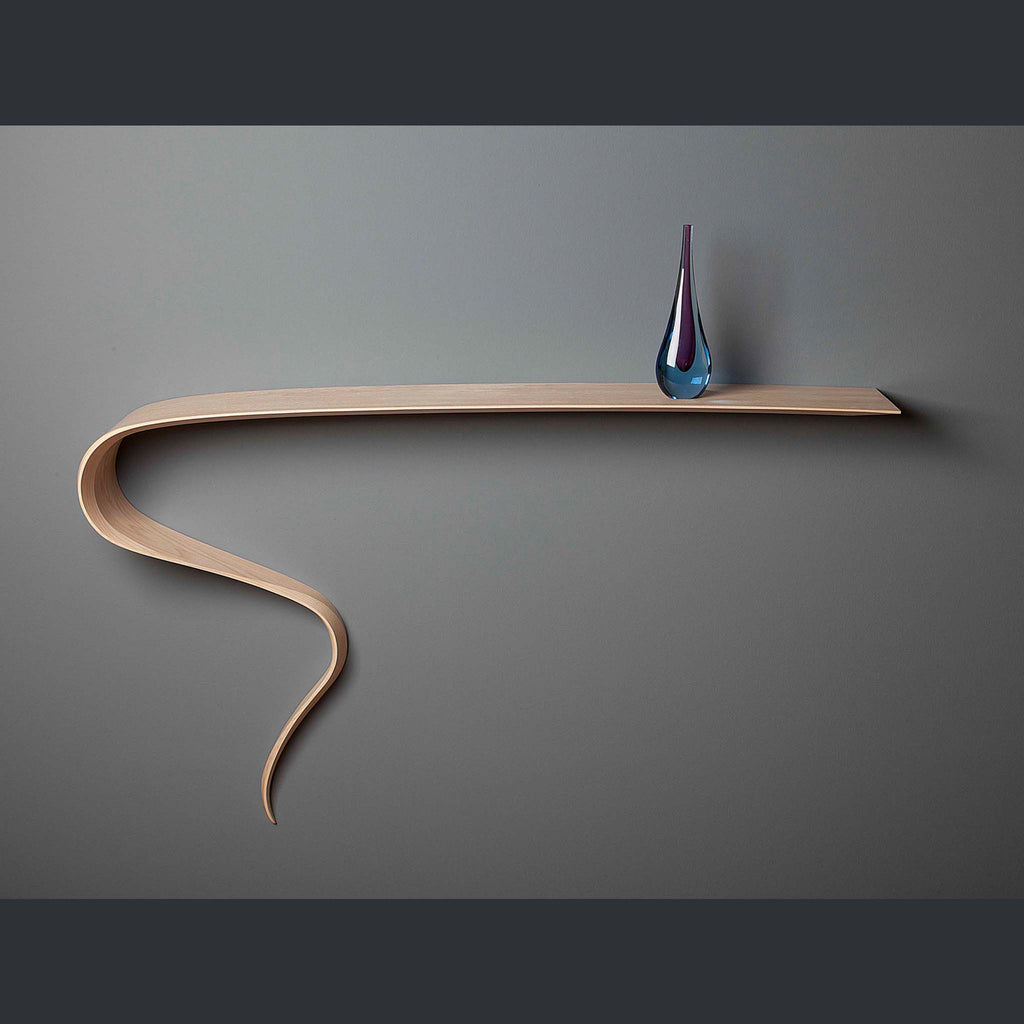 A shelf with a swirling tail