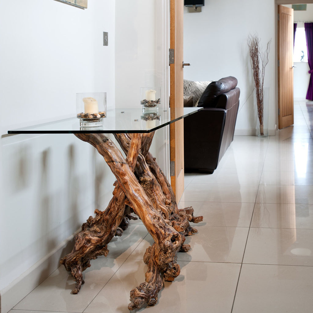 Console table with grapevine wood legs and a glass tabletop