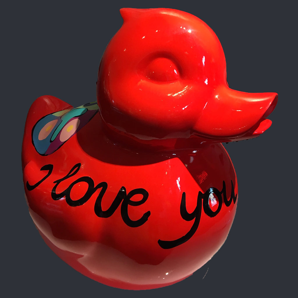 Large red duck with writing in black saying I love you