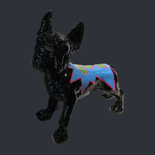 Black French bull dog sculpture with word 'Pop' written on its back in pop art style