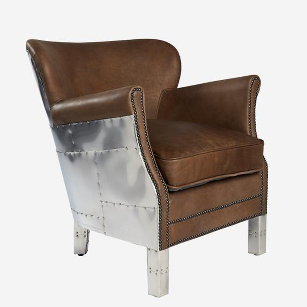 Small brown leather armchair with a metal panel shell inspired by Spitfire aircraft