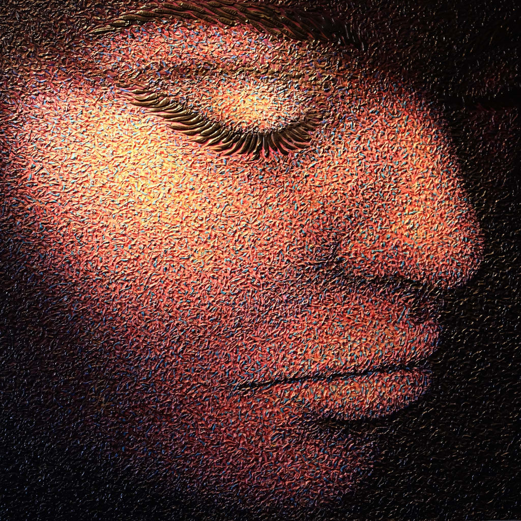 A close up of a calm face by Kieran Crowder