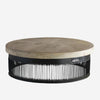Low level large round coffee table with black iron base and cream coloured wooden top