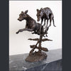 Two lurchers racing. A sculpture made from bronze.